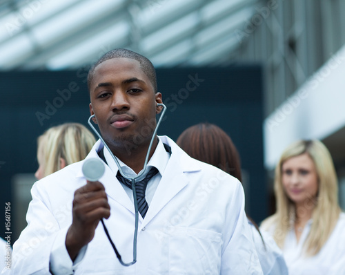 Handsome Afro-American doctor leading his team