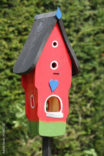 A Brightly Decorated and Colourful Wooden Bird Box.