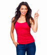 Happy young girl in red top standing against isolated white
