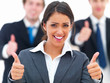Portrait of happy young businesswoman showing thumbs up sign