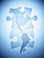 Symbolic puzzle pieces combined with map of North America