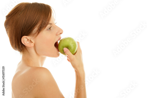 Portrait of young beauty woman eating green apple