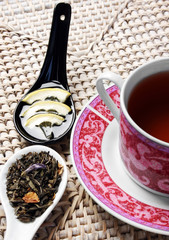 Cup of tea with honey, lemon and herbals