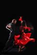 dancer in action against black background
