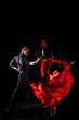 dancers against black background in action