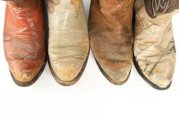 Old worn cowboy boot toes
