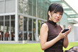 Asian Woman With Mobile Phone