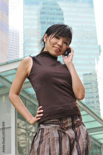 Beautiful Young Asian Woman With Mobile Phone