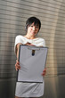 Young Asian Woman With Clipboard