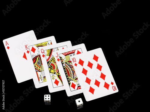 The dice and playing cards on black background.