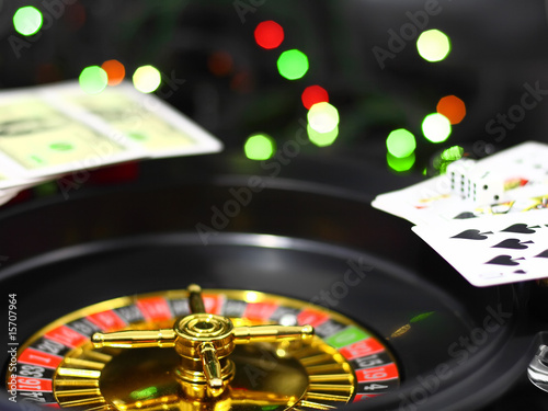 The casino roulette and playing cards. On background- casino