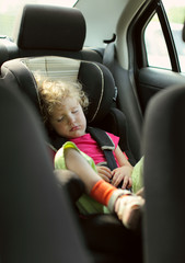 Сhild sleeps in the car