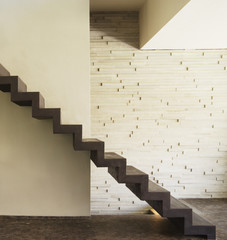 Modern stairs in front of wall