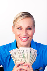 Businesswoman holding money in her hands