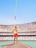 Athlete with pole vault in an arena