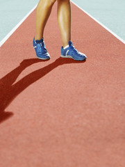 Athlete's feet on a track