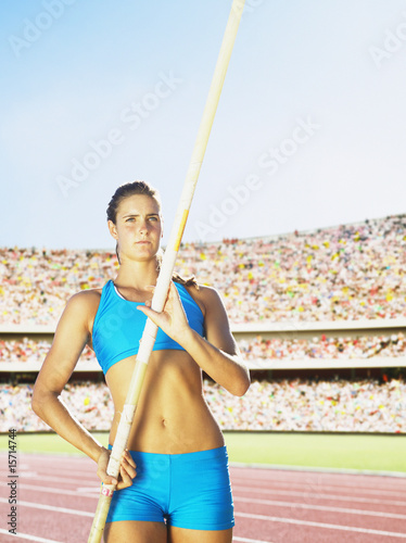 Athlete pole vaulting in an arena