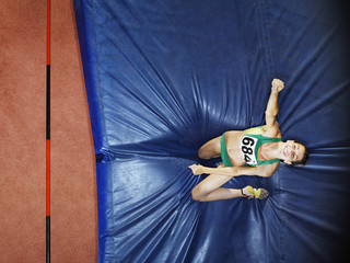 Athlete on a crash mat after high jumping
