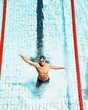 Swimmer in pool happy with arms up