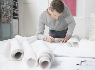 Architect working on drafts in office
