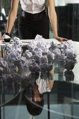 Businesswoman standing with crumpled papers in an office