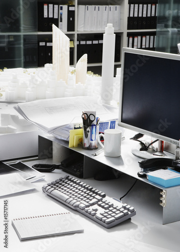 Empty desk with large city model in office