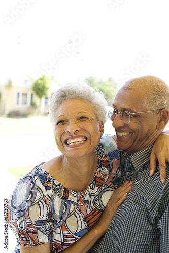 Couple embracing outdoors smiling