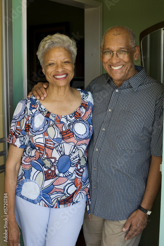 Couple embracing standing in doorway