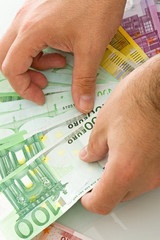 Euro banknotes in the hand