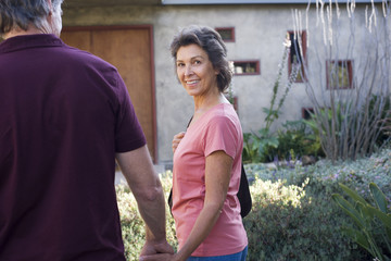 Couple arriving home holding hands