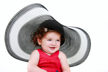 cute toddler girl in big hat