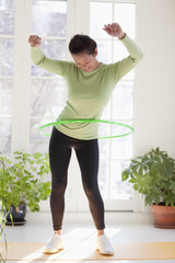 Woman exercising with hula hoop