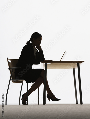 Businesswoman at a table on a laptop
