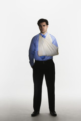 Man with broken arm in sling
