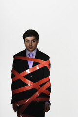 Businessman with duct tape around him