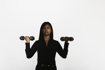 Woman holding two small free weights