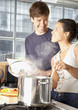 Couple making meal in kitchen