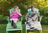 Mature Couple with Their Electronic Devices