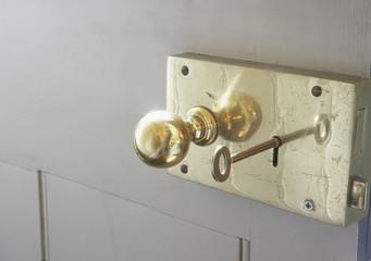 Doorknob and key in keyhole