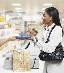 Woman paying for items at a cashier in store