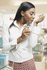 Woman testing perfume in a store