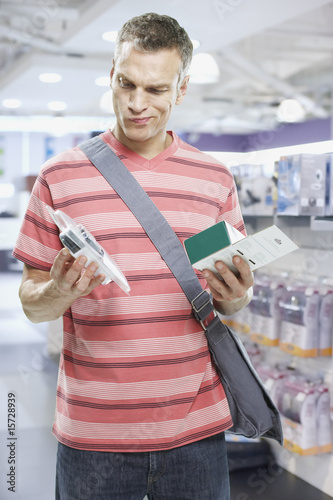 Man looking at electronics in store