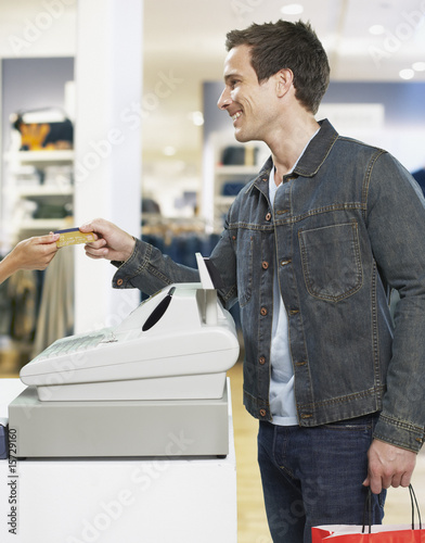 Man paying for items at cashier in store
