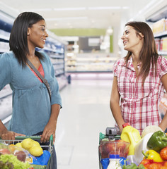 Two women grocery shopping