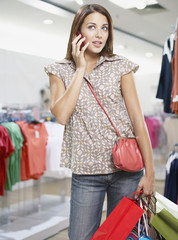 Woman on cellular phone in store