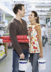 Couple shopping for paint and wallpaper