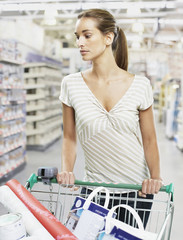 Woman shopping for paint and wallpaper