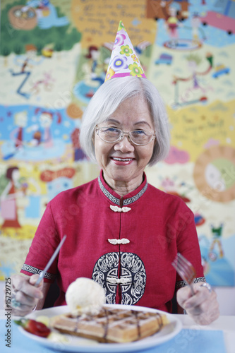 Woman at party with plate of waffles