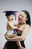 Woman and young boy in graduation cap