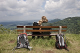 young couple take a break at a hiking tour